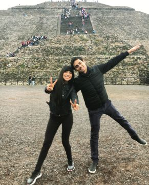 Couple wearing all black in front of the Pyramid of the Sun in Mexico Teotihuacan Pyramids