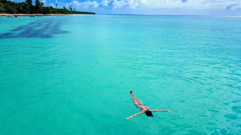Girl floating in the Caribbean Sea near Punta Cana