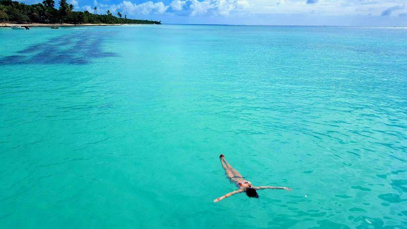 Girl floating in the Caribbean Sea near Punta Cana