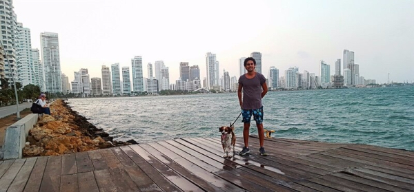 Man with dog along the water in Bocagrande, Cartagena.