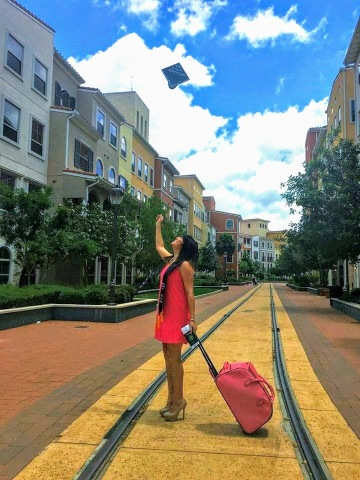 graduation cap and travel suitcase photo