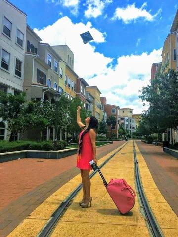 graduation cap and travel suitcase photo